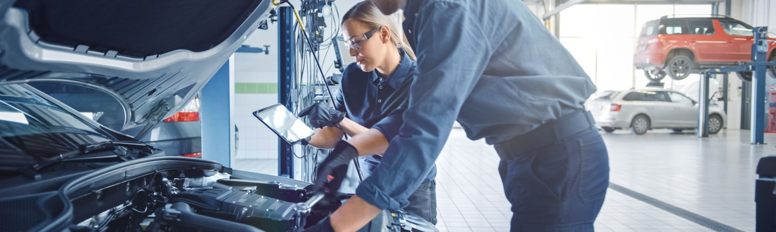 Technicians Working On Vehicle